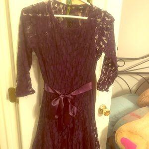 Purple lace tea length dress with tie waist